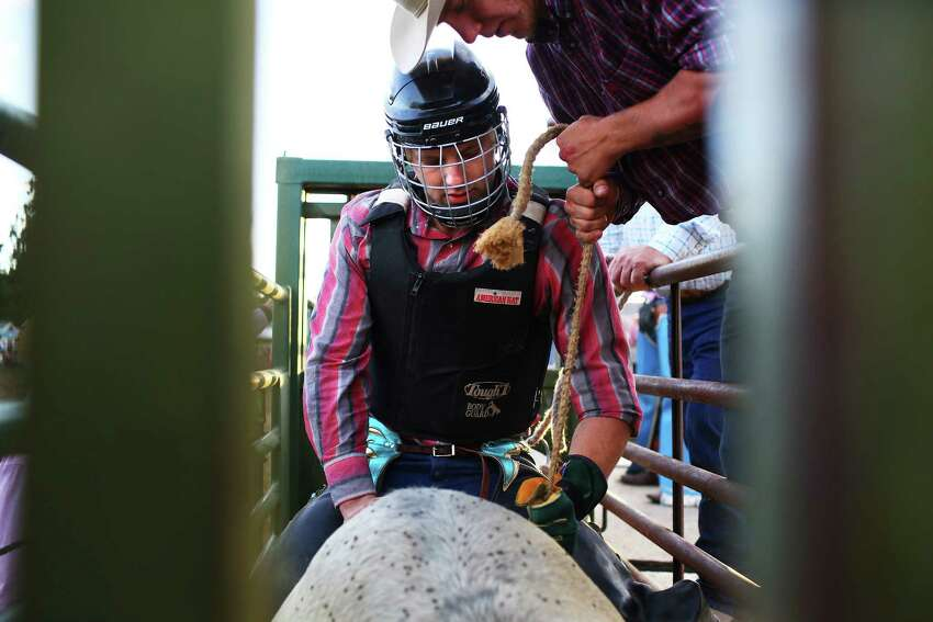 Tyler Dodson preps for the Bull Riding event in the chute during the Sedro-Woolley Riding Club Rodeo, Sunday, July 3, 2016 at the Sedro-Woolley rodeo grounds. The rodeo is a part of the annual