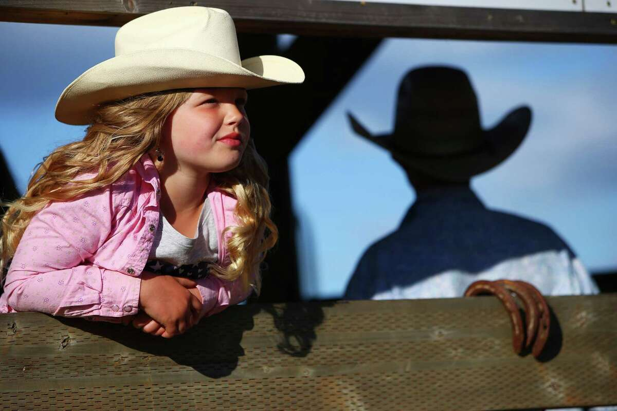 Macie Purcell, 7, watches the tie-down roping event during the Sedro-Woolley Riding Club Rodeo, Sunday, July 3, 2016 at the Sedro-Woolley rodeo grounds. The rodeo is a part of the annual