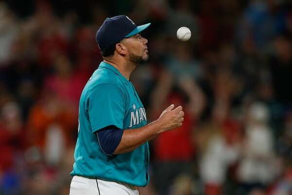 SEATTLE, WA - JUNE 24:  Relief pitcher Joaquin Benoit #53 of the Seattle Mariners reacts after hitting Aledmys Diaz of the St. Louis Cardinals with the bases loaded to tie the game at 1-1 in the eighth inning at Safeco Field on June 24, 2016 in Seattle, Washington.  (Photo by Otto Greule Jr/Getty Images)