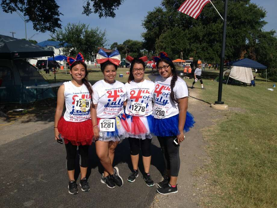 (From left) Analy Sanchez,19; Jacklyn Garcia,20; Aracely Cabrera,20; Arina Palacion,19. Local college students ran the 5k on Monday to support Cabrera, who had to run as part of a jogging course she's taking at Palo Alto College this summer. Photo: Liz Lepro