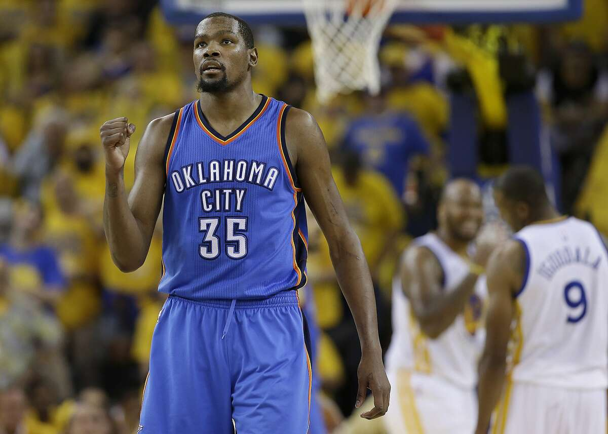 FILE - In a Monday, May 30, 2016 file photo, Oklahoma City Thunder forward Kevin Durant (35) reacts during the second half of Game 7 of the NBA basketball Western Conference finals against the Golden State Warriors in Oakland, Calif. Durant announced Monday, July 4, 2016, that he is joining All-Stars Stephen Curry and Klay Thompson with the Golden State Warriors. Durant made the decision public on The Players� Tribune Monday morning. He can�t officially sign until July 7. (AP Photo/Marcio Jose Sanchez, File)