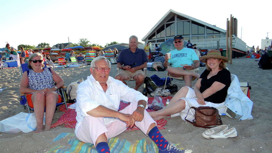 Ann and Jeff Milller, of Weston, Banning Repplier, of Brooklyn, NY, Ed Gerber, of Westport, and Dinny Jensen, of Virginia, enjoy Fairfield's Independence Day Fireworks Show at Penfield Beach Saturday night. Photo: Mike Lauterborn / For Hearst Connecticut Media / Fairfield Citizen