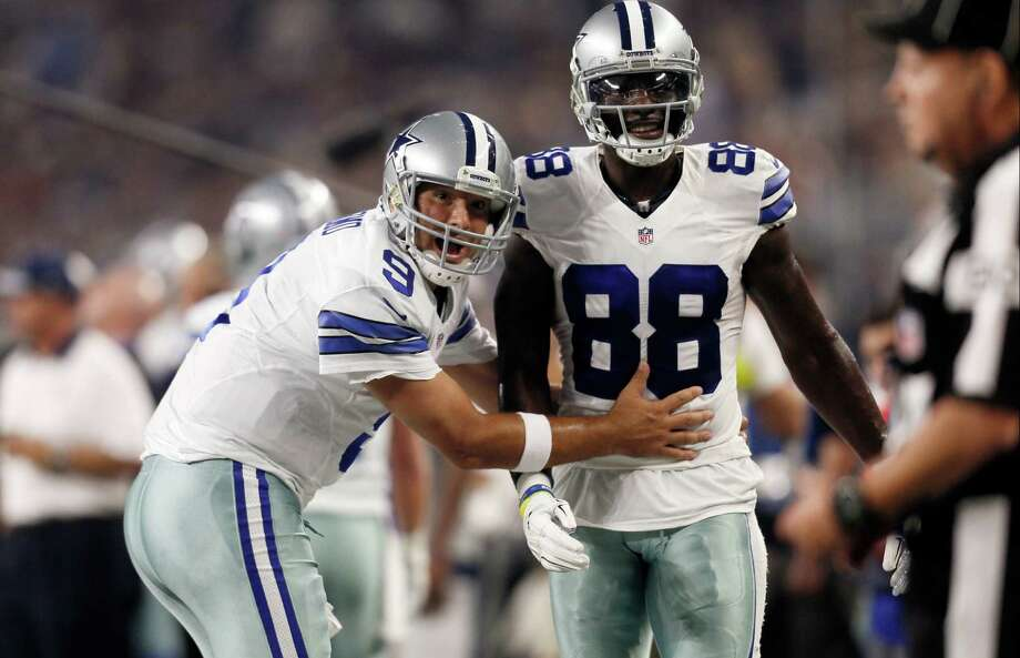 Dallas Cowboys quarterback Tony Romo and wide receiver Dez Bryant react during the first half against the New York Giants in Arlington on Sept. 13, 2015. Both are eager to get on the field together after injuries kept them apart most of last season, when Dallas slid from first to worst in the NFC East. Photo: Brandon Wade /Associated Press / FR168019 AP