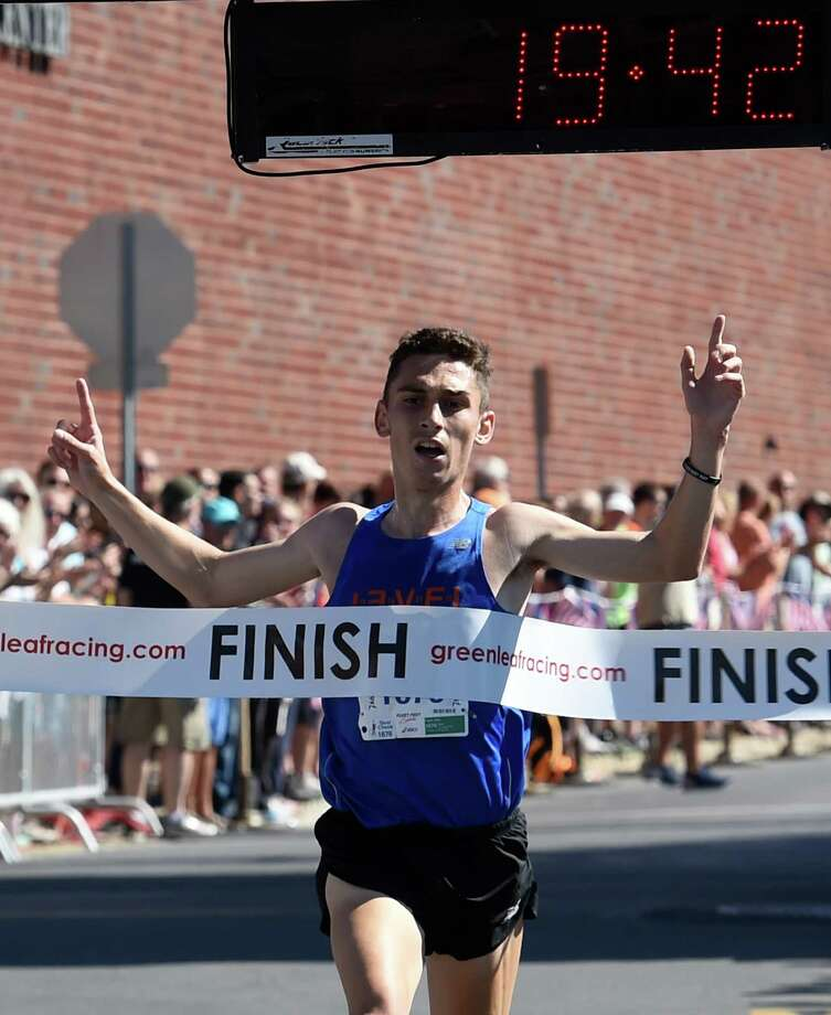 Ben Fazio crosses the finish line as the Men's winner in the Firecracker 4 mile race Monday July 4, 2016 Saratoga Springs, N.Y. (Skip Dickstein/Times Union) Photo: SKIP DICKSTEIN / 40037126A