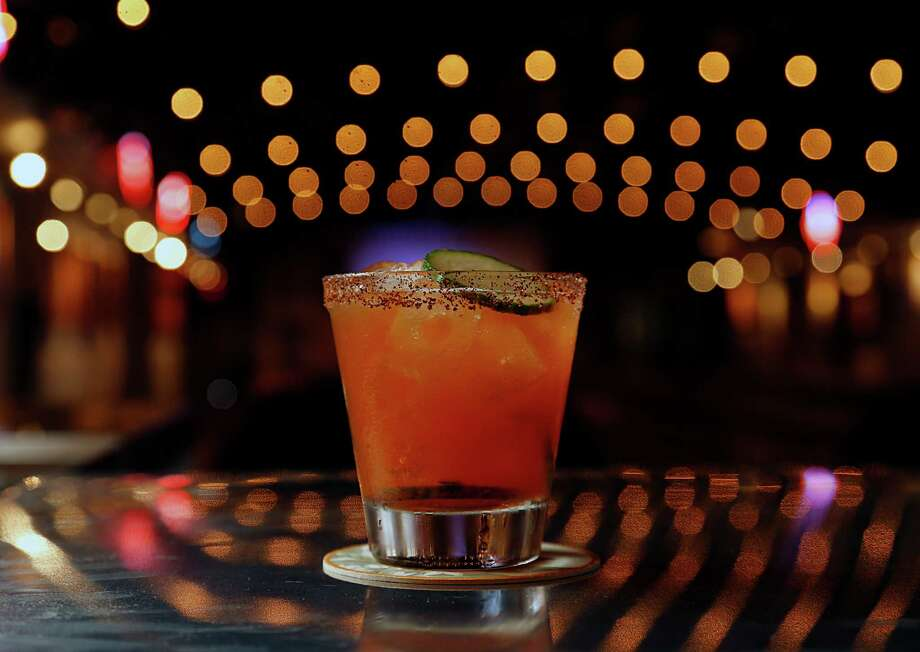 The El Guapo Viejo cocktail at Goode Co. Armadillo Palace. It was prepared by beverage director Rob Crabtree, named one of the Best New Mixologists of 2016 by Food & Wine magazine. Photo: James Nielsen, Staff / © 2016  Houston Chronicle