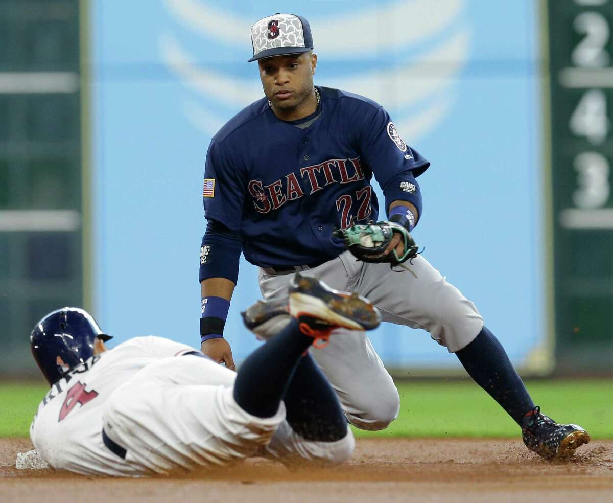 Houston Astros George Springer slides safe into second base against Seattle Mariners Robinson Cano during the first inning at Minute Maid Park Monday, July 4, 2016, in Houston.