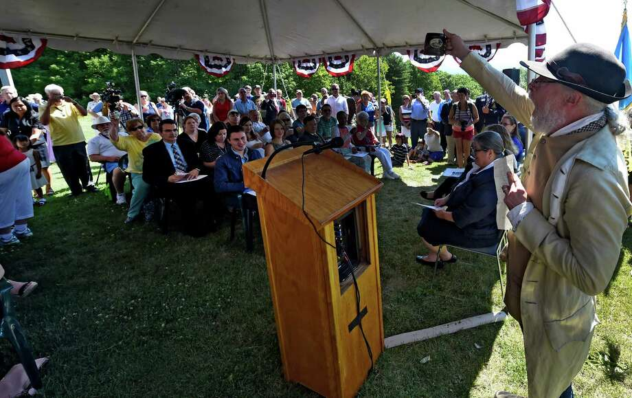 Park ranger Joe Craig, dressed in period costume Toasts to the Declaration of Independence at the Citizenship Ceremony Monday July 4, 2016 at the Saratoga National Historical Park in Stillwater, N.Y. (Skip Dickstein/Times Union) Photo: SKIP DICKSTEIN / 40037141A