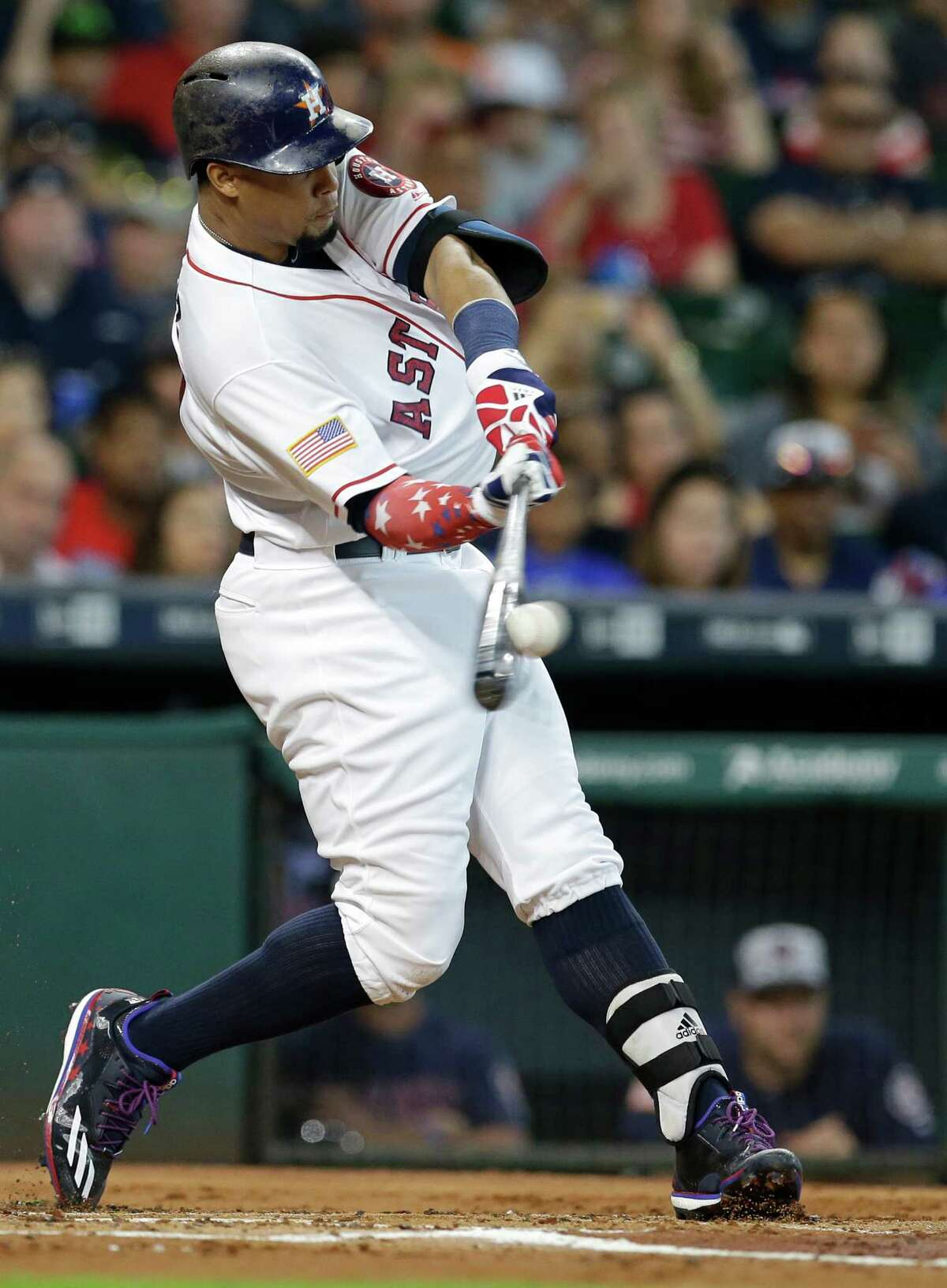Houston Astros Carlos Gomez hits against the Seattle Mariners during the first inning at Minute Maid Park Monday, July 4, 2016, in Houston.