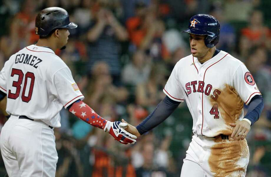 July 4: Astros 2, Mariners 1Houston Astros Carlos Gomez welcomes George Springer as he crosses the plate scoring on a sacrifice fly hit by Luis Valbuena against the Seattle Mariners during the first inning at Minute Maid Park Monday, July 4, 2016, in Houston. Photo: Melissa Phillip, Houston Chronicle / © 2016 Houston Chronicle