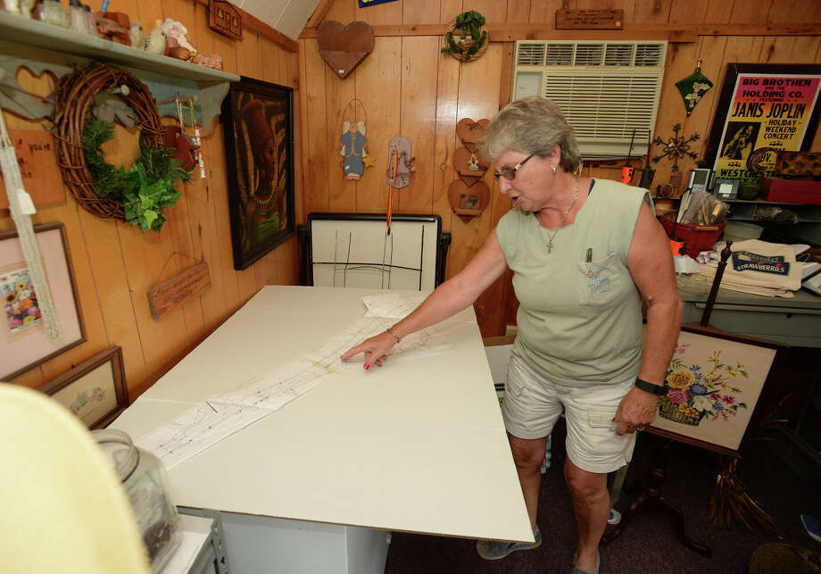 Sandy Hodge looks over the schematics of the Concord Road Project at her shop on Concord Road Thursday. Hodge said she is frustrated with the years long project. Photo taken Thursday, June 30, 2016 Guiseppe Barranco/The Enterprise Photo: Guiseppe Barranco, Photo Editor
