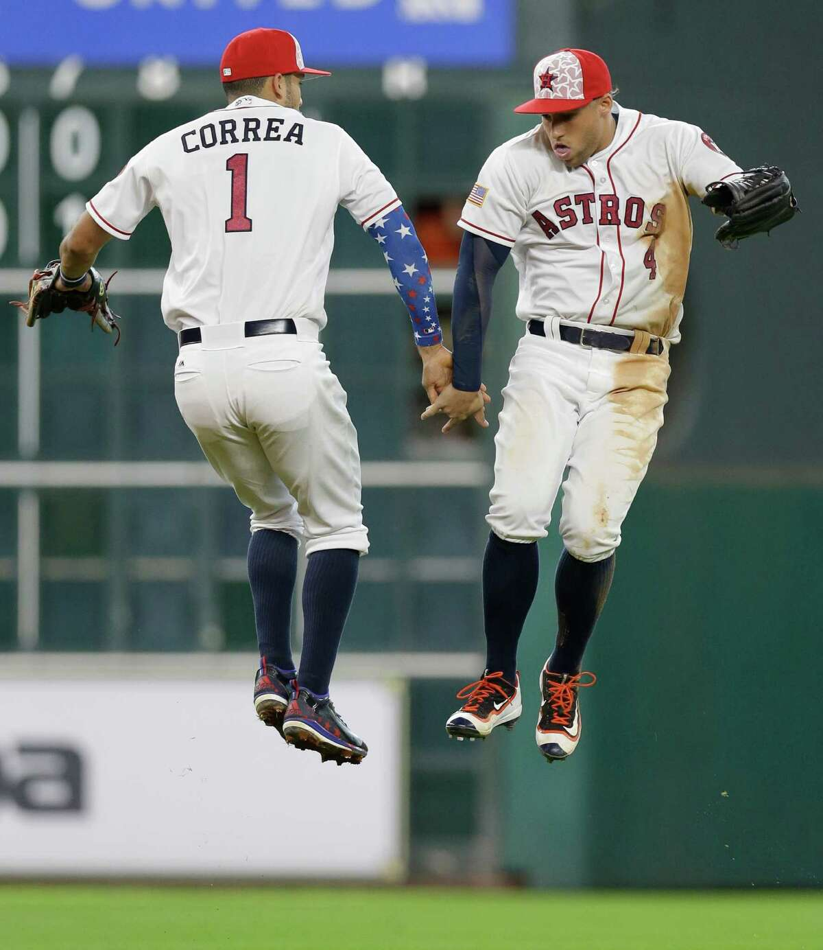 Houston Astros Carlos Correa and George Springer celebrate win over the Seattle Mariners at Minute Maid Park Monday, July 4, 2016, in Houston.