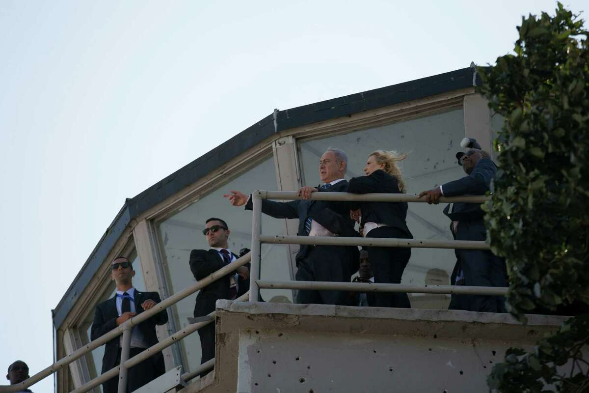 Israeli Prime Minister Benjamin Netanyahu and his wife, Sara, stand on the control tower at the old Entebbe airport in Uganda.