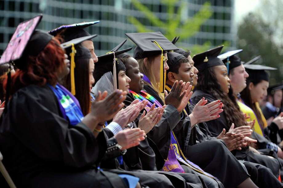 Graduates applaud Eric Jolly, president and CEO of Minnesota Philanthropy Partners, at the end of his address at the University at Albany undergraduate Commencement Ceremony on Sunday, May 15, 2016, in Albany, N.Y.  Jolly was the commencement speaker.  The college graduated approximately 2,197 students on Sunday.  (Paul Buckowski / Times Union) Photo: PAUL BUCKOWSKI / 10036378A