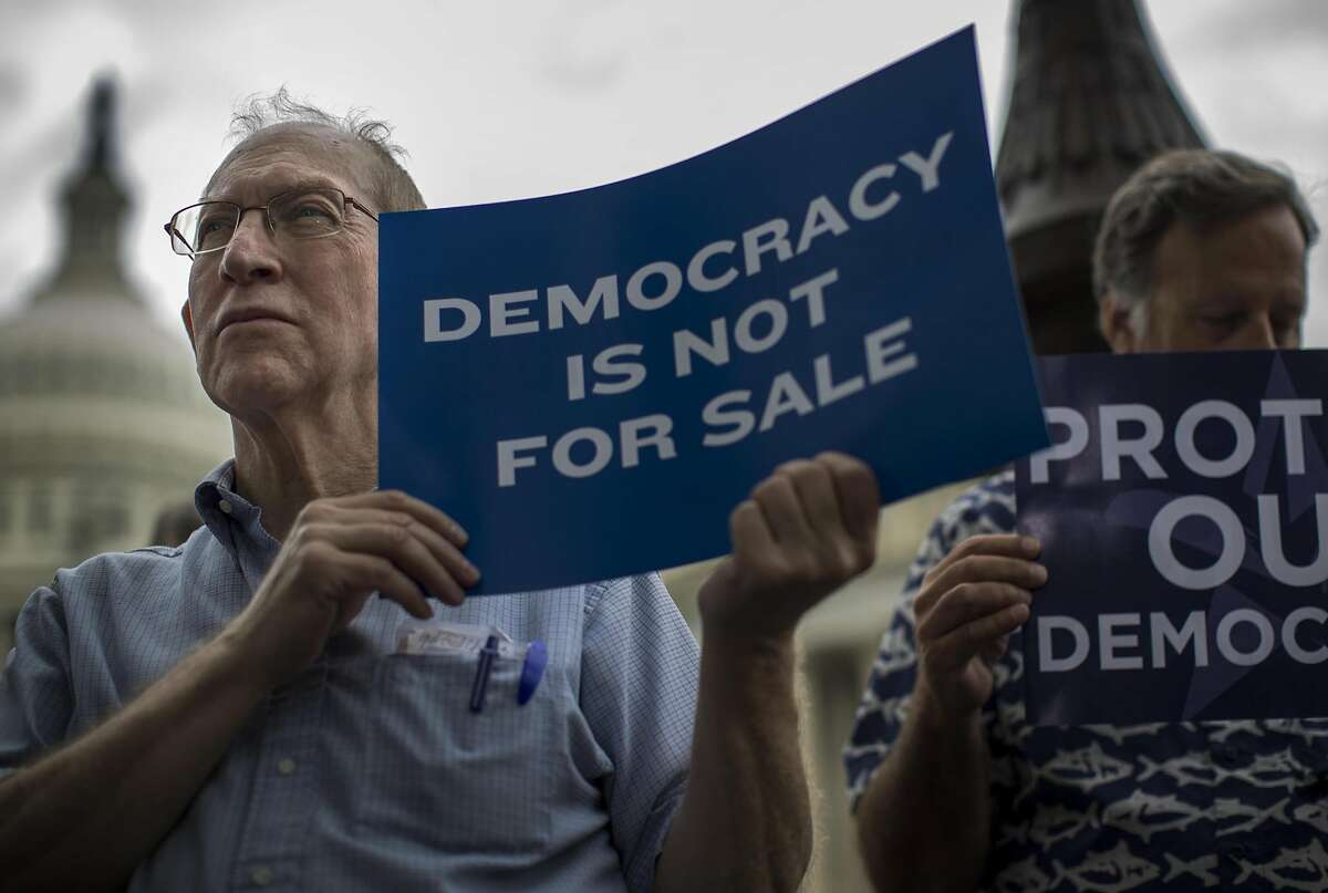 Hank Ickes, left, from Arlington, Virginia, and others gather at a press conference on Capitol Hill in Washington, D.C., on Sept. 8, 2014, to discuss a Constitutional Amendment on campaign finance reform overturning Citizens United.