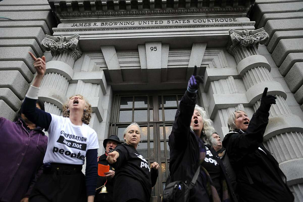 A small flash mob dances on the steps of the court house. In conjunction with Occupy West, Protestors gather in front of the 9th Circuit Court of Appeals in San Francisco to demand a change to the