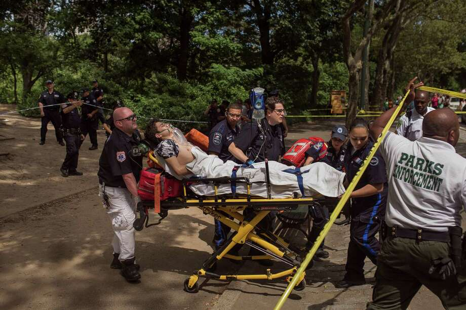 A injured man is carried to an ambulance in Central Park in New York, Sunday, July 3, 2016. Authorities say a man was seriously hurt in Central Park and people near the area reported hearing some kind of explosion. Fire officials say it happened shortly before 11 a.m., inside the park at 68th Street and Fifth Avenue.  (AP Photo/Andres Kudacki) ORG XMIT: NYAK104 Photo: Andres Kudacki / FR170905 AP