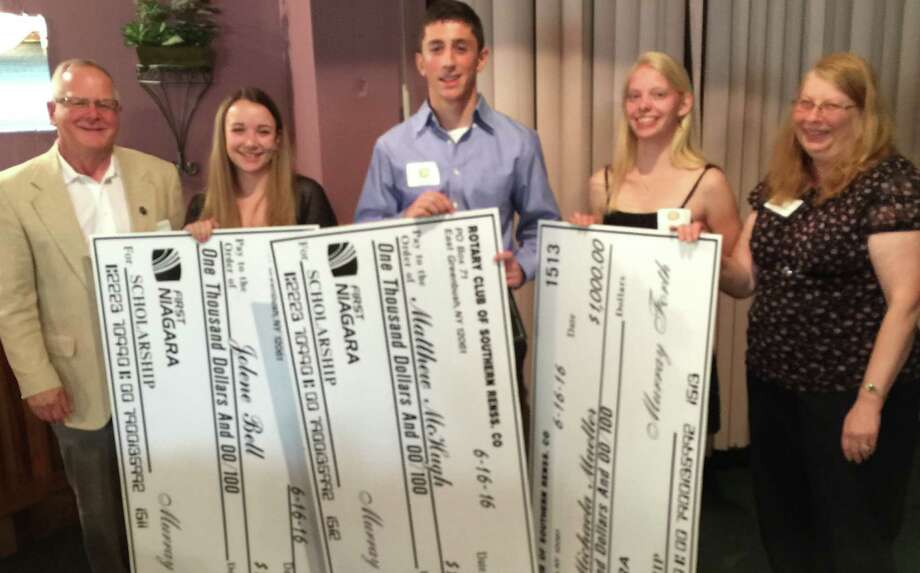 A trio of high school seniors, flanked by club president Terry Brewer (far left) and president-elect Debbie Rodriguez (far right), pose with their oversized $1,000 citizenship/scholarship checks awarded by the Southern Rensselaer County Rotary Club. The students, nominated by their respective schools based on academic, civic, and extracurricular achievements, are, left to right: Jolene Bell of Rensselaer High School, who will study dance at the University of Utah; Matt McHugh of Columbia High School, who will study biology at Siena College; and, Michaela Mueller of Maple Hill High School, who will study civil engineering at the University of Hartford. (Southern Rensselaer Rotary Club)