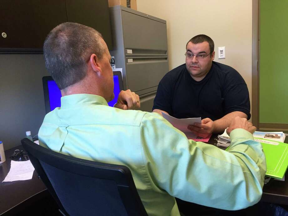 Daniel Maldonado, right, goes over PROS program class offerings with Program Director Harlan Hall at Unity House in mid-June, 2016. (Claire Hughes / Times Union)
