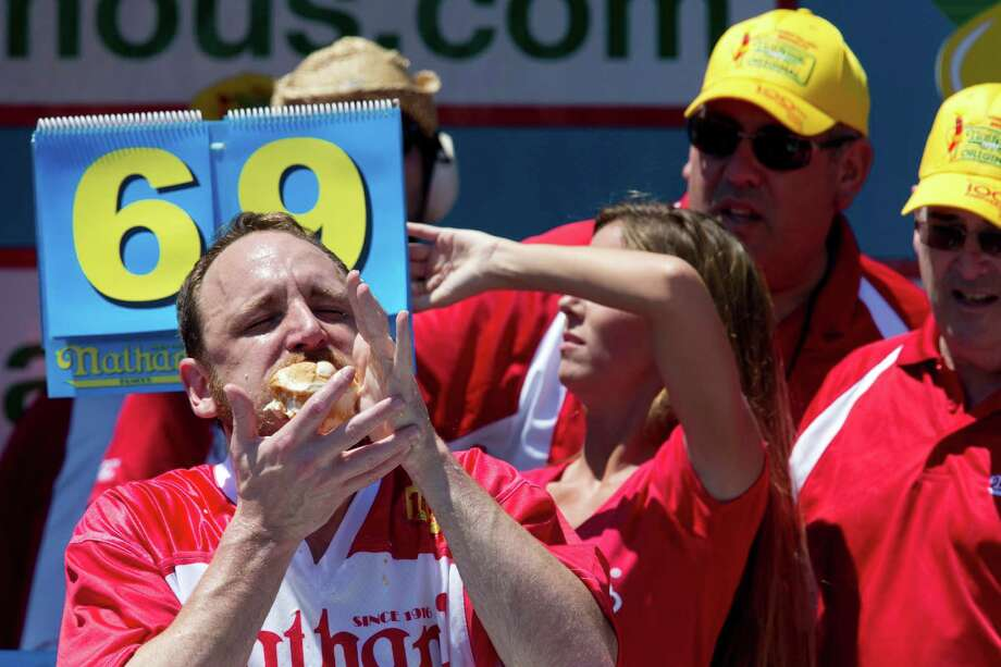 Joey Chestnut competes in Nathan's Famous Fourth of July International Hot Dog Eating Contest men's competition, Monday, July 4, 2016, in New York. Chestnut came in first eating 70 hot dogs and buns in 10 minutes. Matt Stonie came in second eating 53 hot dogs and buns in 10 minutes. (AP Photo/Mary Altaffer) ORG XMIT: NYMA110 Photo: Mary Altaffer / Copyright 2016 The Associated Press. All rights reserved. This m