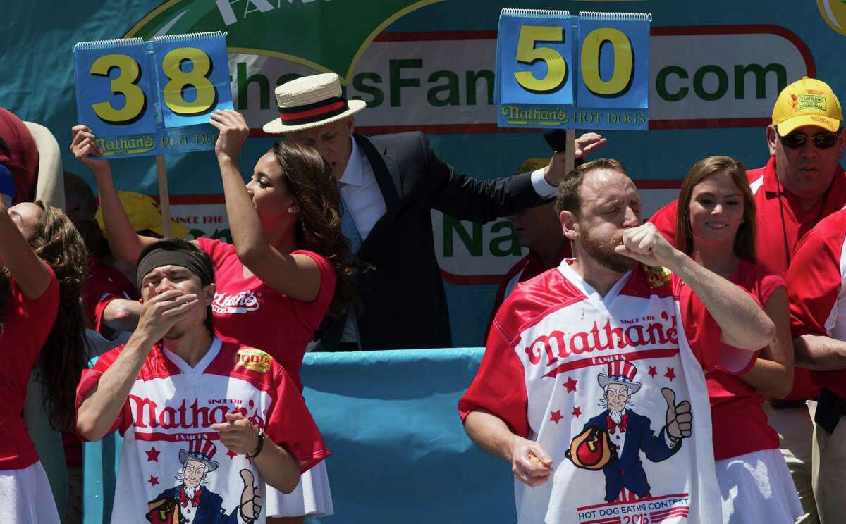 Matt Stonie, left, and Joey Chestnut compete in Nathan's Famous Fourth of July International Hot Dog Eating Contest men's competition, Monday, July 4, 2016, in New York. Chestnut came in first eating 70 hot dogs and buns in 10 minutes. Stonie came in second eating 53 hot dogs and buns in 10 minutes. (AP Photo/Mary Altaffer) ORG XMIT: NYMA109