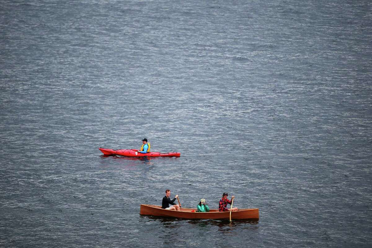 Kayaks and canoes float on Lake Union during Fourth of July celebrations at Gas Works Park, Monday, July 4, 2016.