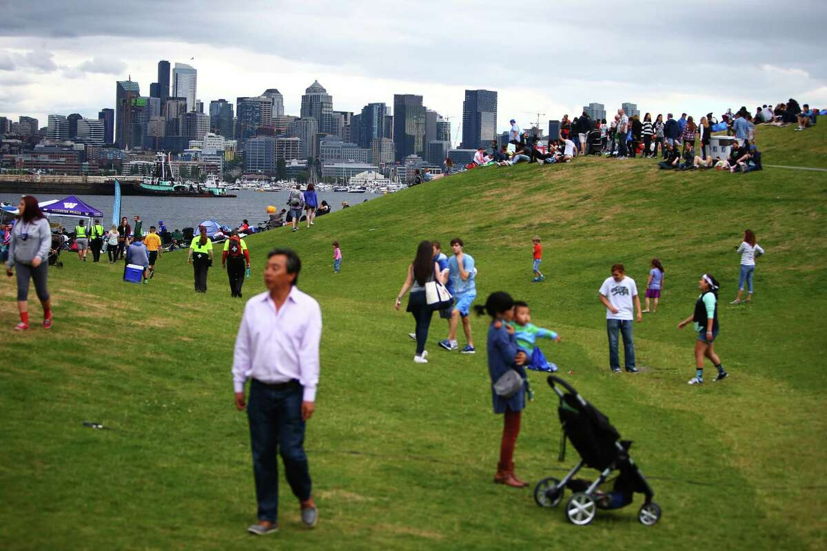 Crowds gather during Fourth of July celebrations at Gas Works Park, Monday, July 4, 2016. Seattle's 15 largest parks and beaches will close this weekend to help slow the spread of the novel coronavirus as people have continued to congregate in these spaces, the mayor's office announced Thursday.