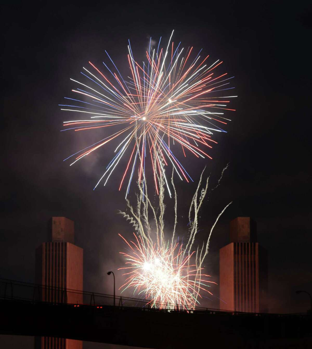 Fireworks fill the sky over Albany during New York State?'s Fourth of July Celebration presented by Price Chopper & Market 32 at the Empire State Plaza on Monday night, July 4, 2016, viewed from Rensselaer, N.Y. (Will Waldron/Times Union)