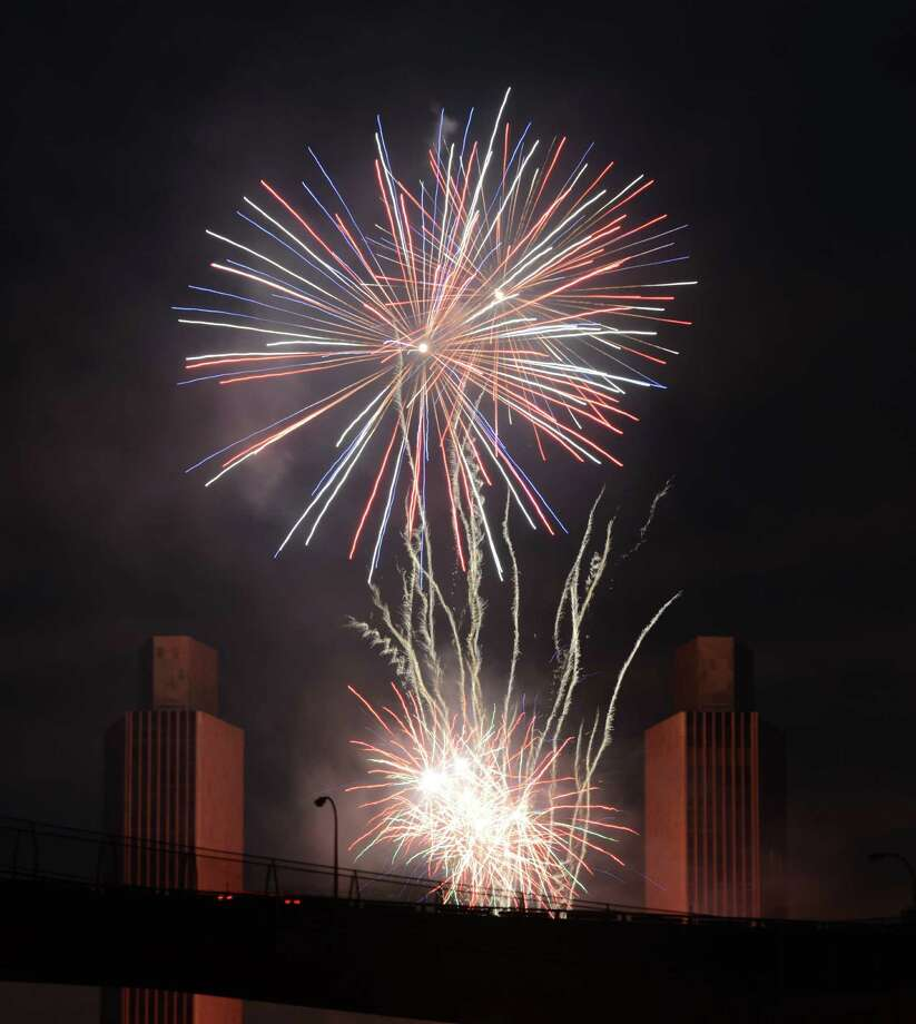 Fireworks fill the sky over Albany during New York State's Fourth of July Celebration presented by Price Chopper & Market 32 at the Empire State Plaza on Monday night, July 4, 2016, viewed from Rensselaer, N.Y. (Will Waldron/Times Union) Photo: Will Waldron / 20037195A