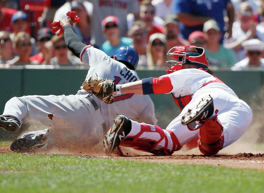 Boston Red Sox's Sandy Leon, right, tags out Texas Rangers' Shin-Soo Choo at home plate during the fourth inning of a baseball game in Boston, Monday, July 4, 2016. (AP Photo/Michael Dwyer) ORG XMIT: MAMD108 Photo: Michael Dwyer / Copyright 2016 The Associated Press. All rights reserved. This m