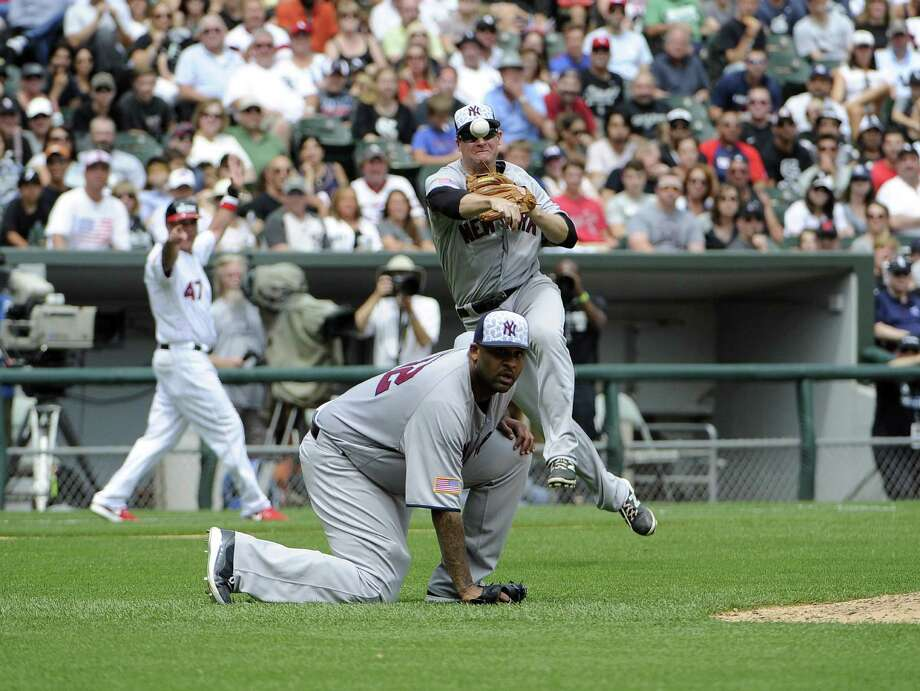 CHICAGO, IL - JULY 04: Chase Headley #12 of the New York Yankees throws over the head of CC Sabathia #52 and throws out Tim Anderson #12 of the Chicago White Sox during the fourth inning on July 4, 2016 at U. S. Cellular Field in Chicago, Illinois.  (Photo by David Banks/Getty Images) ORG XMIT: 607681075 Photo: David Banks / 2016 Getty Images
