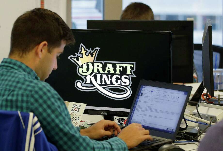 FILE - In this Sept. 9, 2015, file photo, Bear Duker, a marketing manager for strategic partnerships at DraftKings, works at his computer at the company headquarters in Boston. Gambling analysts said the daily fantasy sports company has struggled to break out in the UK since it launched to fanfare there in February 2016. (AP Photo/Stephan Savoia, File) ORG XMIT: BX401 Photo: Stephan Savoia / Copyright 2016 The Associated Press. All rights reserved. This m