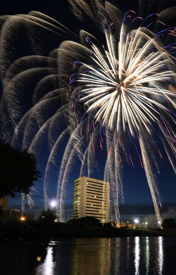 Fireworks explode over the Neches River in Downtown Beaumont Monday night. Independence Day revelers fill Neches River Park to celebrate the holiday and watch the 20 minute display. Photo taken Monday, July 04, 2016 Guiseppe Barranco/The Enterprise Photo: Guiseppe Barranco, Photo Editor