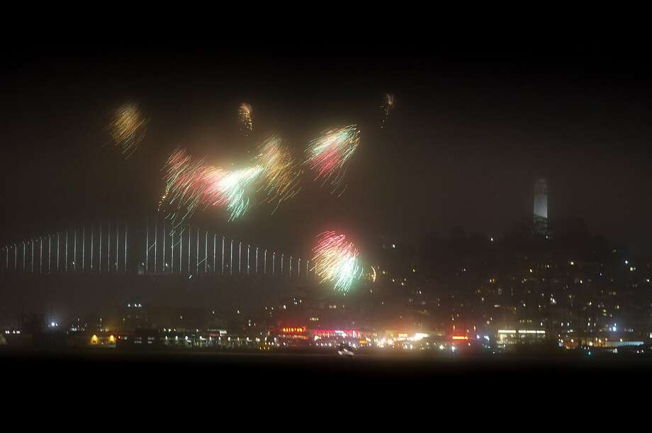 Fireworks light up the foggy sky over San Francisco, Calif., as the city celebrates the Fourth of July on Monday, July 4, 2016. Photo: Carlos Avila Gonzalez, The Chronicle