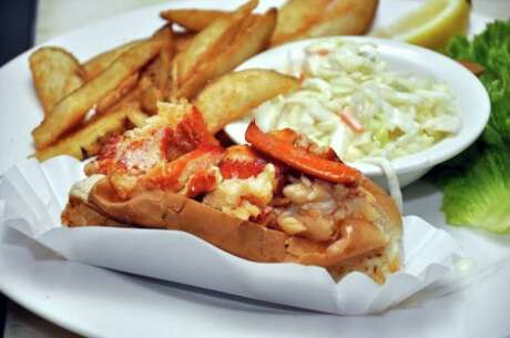 Seven Seas in Milford  has a signature dish: a warm, buttery Connecticut lobster roll.  It consists of three ounces of meat in a grilled top cut long bun.  It comes with a pile of wedge fries and a cup of creamy coleslaw.