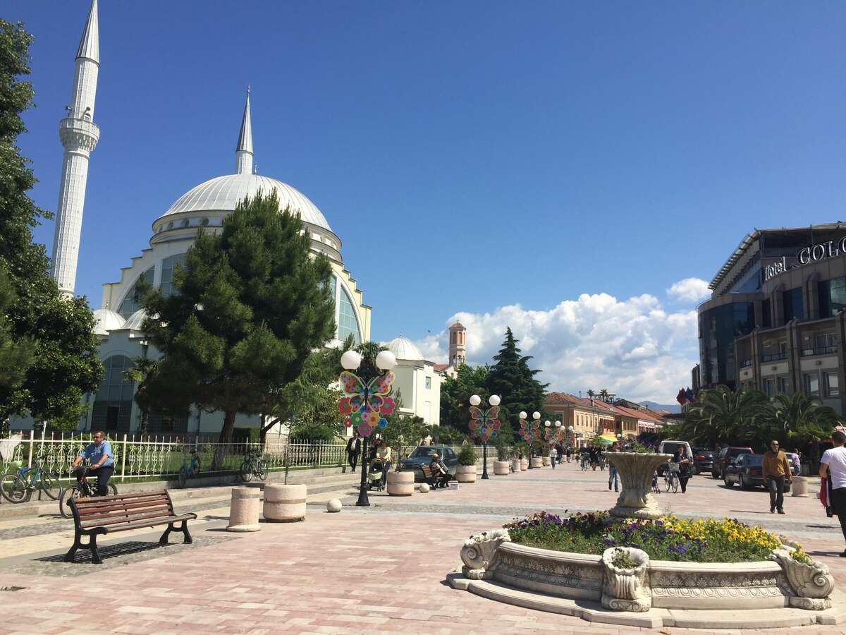 This pedestrian plaza in Shkoder, Albania includes a nearby mosque, restaurants, shops, cafes and a hotel. In the evenings, it's filled with people enjoying a meal or coffee outdoors or taking strolls up and down the plaza. It's a place to see and be seen.