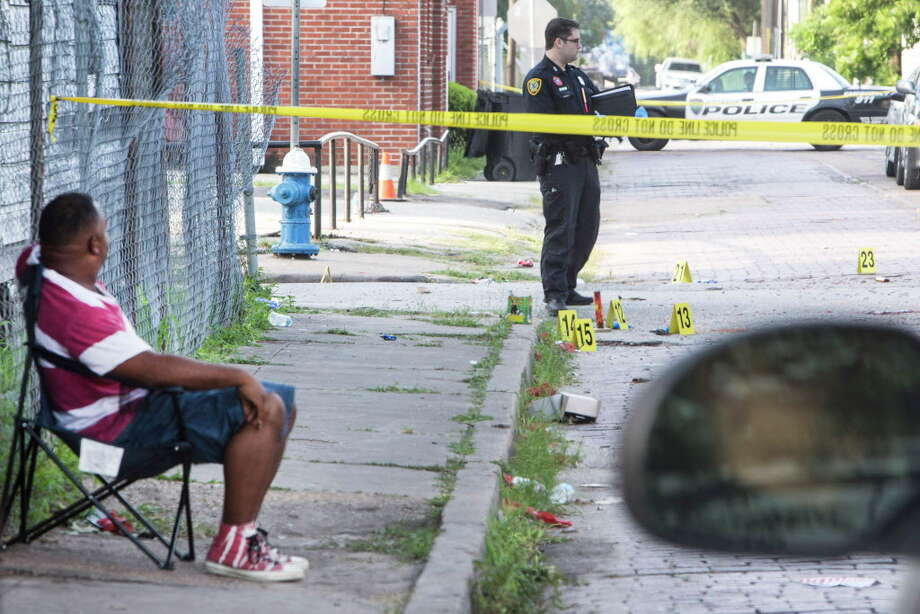 Poice investigate the scene of a fatal shooting in the 1300 block of Robin on Tuesday, July 5, 2016, in Houston. Police say three people were killed in a shooting during a 4th of July party near downtown. In all five people, including a 10-year-old boy, were shot during an argument west of downtown Monday night. Photo: Brett Coomer, Houston Chronicle / © 2016 Houston Chronicle