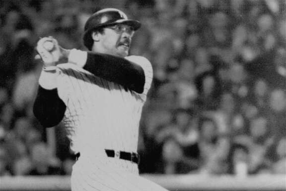 Yankees Reggie Jackson watches the path of the ball as he knocks his second homer in the fifth inning of the World Series game in new York Tuesday, October 18, 1977.  Yanks beat Dodgers 8-4, to win world championship. (AP Photo/stf)