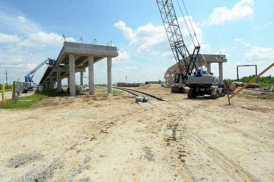 Construction crews continue work on a rail overpass which will connect the Port of Beaumont's property in Orange County, and Jefferson Energy, which leases a portion of the land for its operations, directly to Old U.S. Hwy. 90. The overpass will allow for an easier flow of traffic in and out of the site without disruption by the railroad which currently crosses the entry. Jefferson Energy also is getting to work on a $55 million expansion, with plans to add over 20 storage tanks to the plant. Photo taken Thursday, June 30, 2016 Kim Brent/The Enterprise Photo: Kim Brent / Beaumont Enterprise