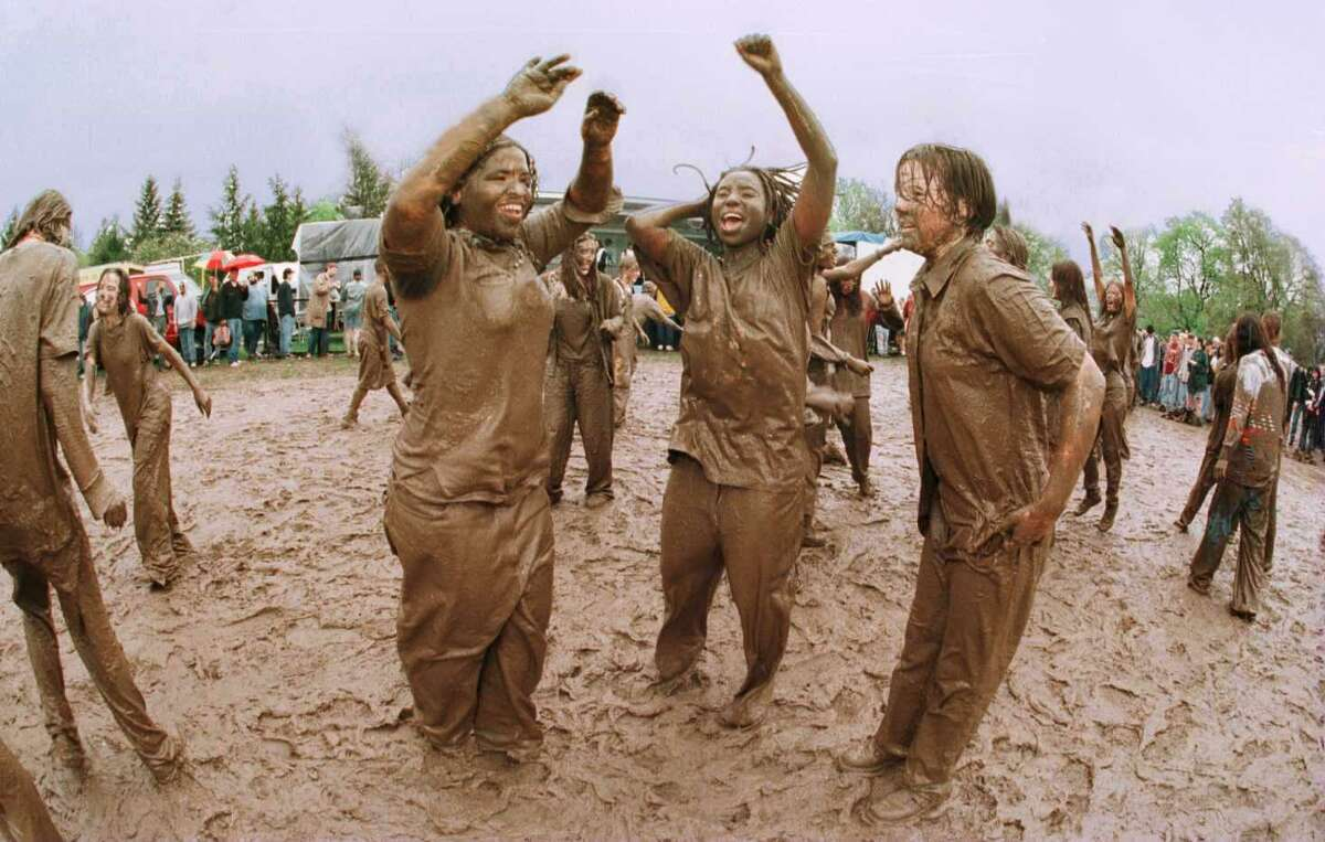 What was summer like 20 years ago in the Capital Region? Click through the slideshow to see it in photos. Tulip Festival turns to mud festival as people waiting for Spin Doctors concert dance to radio music in Washington Park Saturday May 11, 1996.