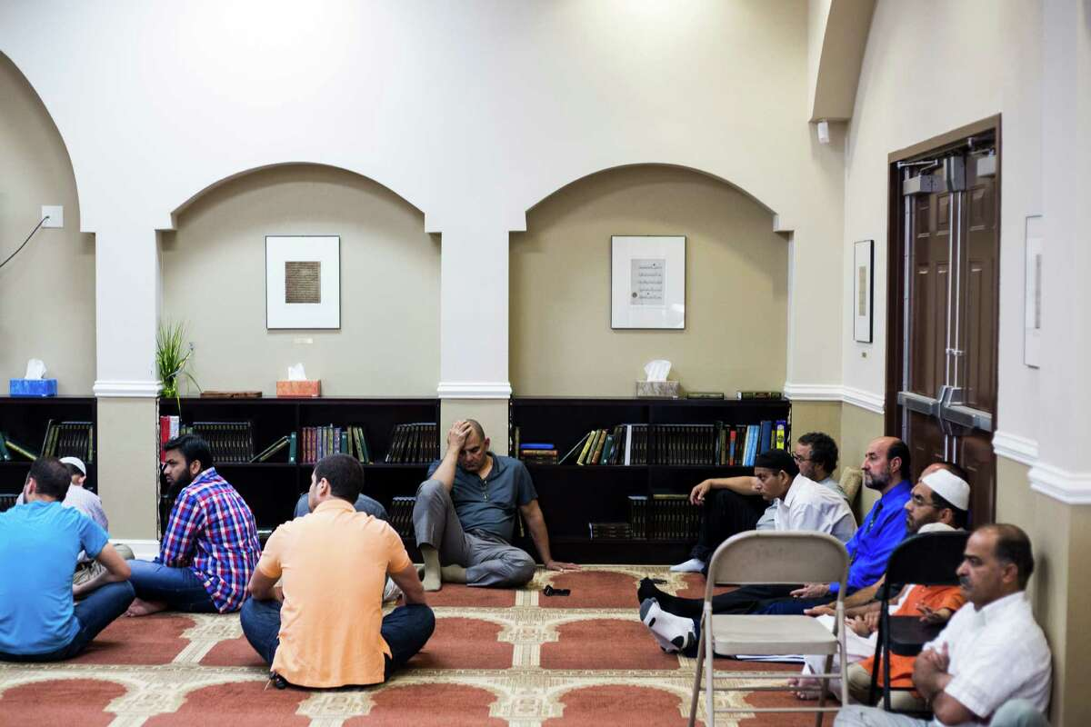 Members at Friday's service at the mosque listen to a sermon by one of the imams, Shaykh Omar Husain, on the dangers of gossip and slander. The month of Ramadan requires reflection and introspection, not just daylong fasting.