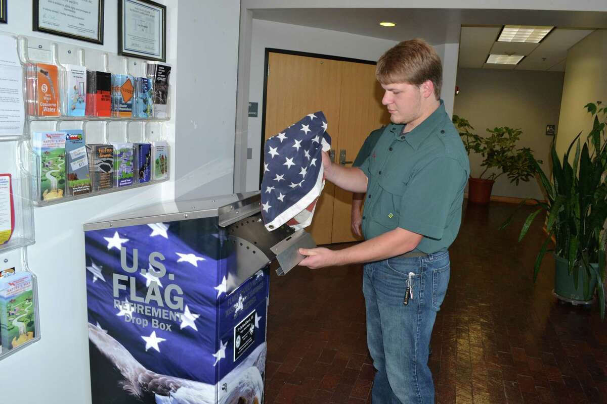 Garland Davis, above, built a U.S. flag drop box for his Eagle Scout project from an old utility bill drop box that is at the Tomball Public Works Department.