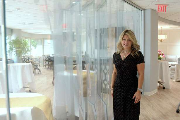 Carolyn Allsen, an onocology nurse navigator, stands by a glass wall etched with a forest scene, in the new Canopy Survivorship Center. Carolyn Allsen, an onocology nurse navigator, stands by a glass wall etched with a forest scene, in the new Canopy Survivorship Center.