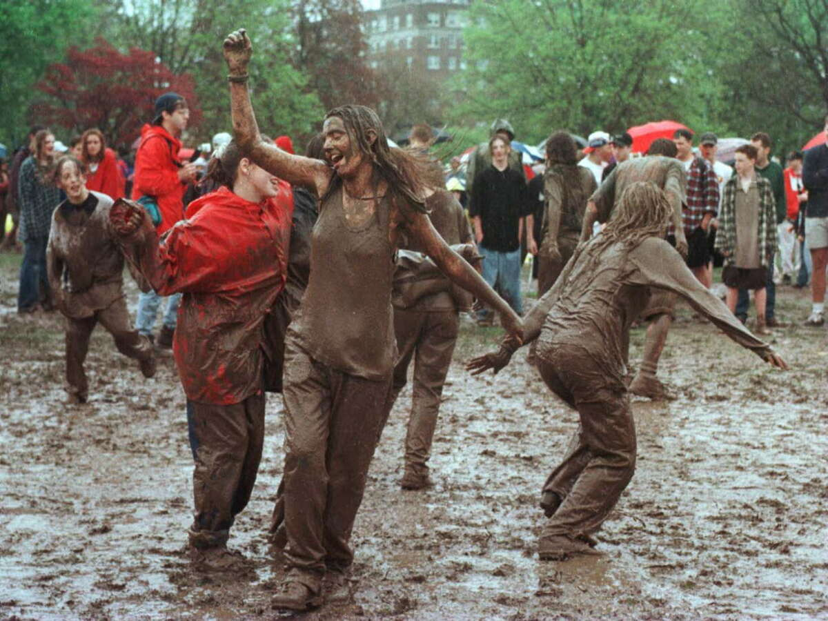 Tulip Festival turns to mud festival as people waiting for a Spin Doctors concert dance to radio music in Washington Park Saturday May 11, 1996.