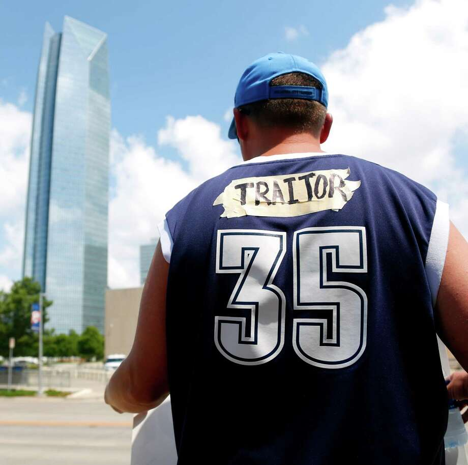 "A man from Mustang, Okla., wrote ""traitor"" on tape over ""Durant"" on the back of his Kevin Durant jersey in front of the Chesapeake Energy Arena in Oklahoma City, Monday, July 4, 2016. Oklahoma City Thunder forward Kevin Durant announced Monday that he will sign with the Golden State Warriors. (Kurt Steiss/The Oklahoman via AP) Photo: Kurt Steiss, Associated Press / The Oklahoman"