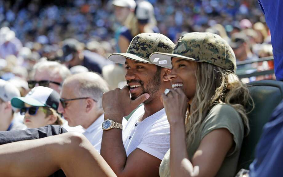 Seattle Seahawks quarterback Russell Wilson, left, sits with girlfriend Ciara at a baseball game between the Seattle Mariners and San Diego Padres Monday, May 30, 2016, in Seattle. (AP Photo/Elaine Thompson) Photo: Elaine Thompson/AP