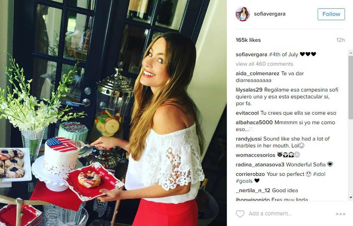 Carbs don't count on July 4th, right? Sofia Vergara is seen here noshing on cakes, doughnuts and other sweets.
