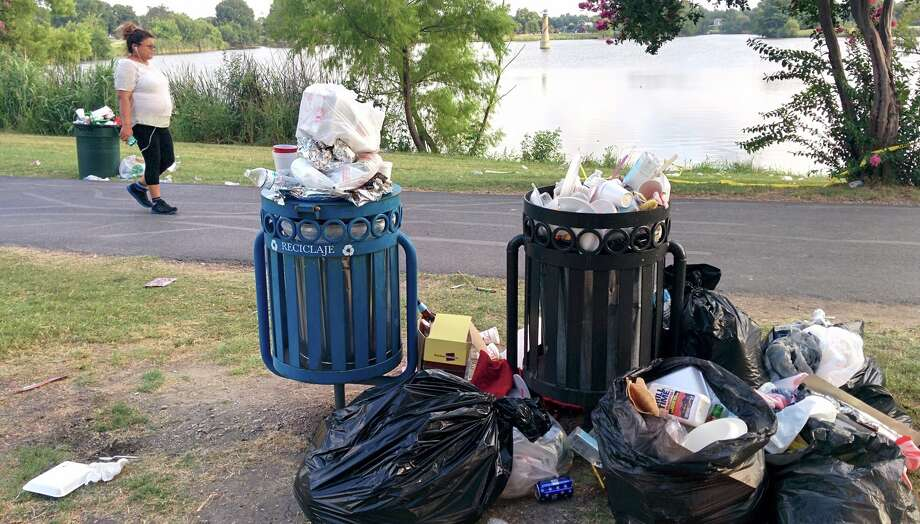 Crews work to clean up trash on July 5, 2016 after the annual Woodlawn Lake Park Fourth of July Celebration. Photo: John Tedesco