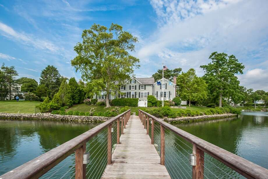 71 Five Mile River Rd, Darien, CT 06820 4 beds 5 baths  Features: Sited on the Five mile River, 270-Degree water views, originally a 1700'S farmhouse and fully rebuilt in 2008, pool, 100' pier and deep water dock, private guest suite  View full listing on Zillow Photo: Zillow