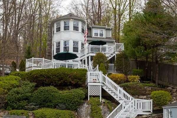 40 Forty Acre Mountain Rd, Danbury, CT 06811   3 beds 4 baths 1,867 sqft   Features: Private dock on Candlewood Lake, three levels, sunroom   View full listing on Zillow