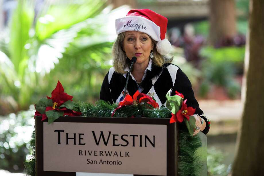 Maggie Thompson, Executive Director of the Paseo Del Rio Association, speaks during a press conference announcing Silver and Black Give Back, a nonprofit associated with the San Antonio Spurs, as the Holiday River parade grand marshal at the Westin Riverwalk in downtown San Antonio on Tuesday, July 5, 2016. Photo: BRITTANY GREESON, Staff / San Antonio Express-News / © 2016 San Antonio Express-News